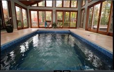 An Original Endless Pools swimming machine installed indoors and fully in-ground in a sunroom in Edison, New Jersey. Endless Pools, Modular Design, Spas, Sunroom, Home And Family, Swimming, Indoor, Homes, The Originals