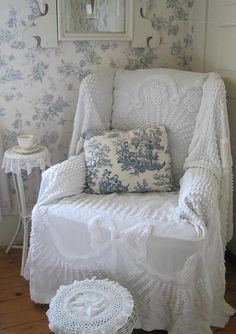 bedspread used as a chair cover. add a toile pillow and it's a new piece of furniture.