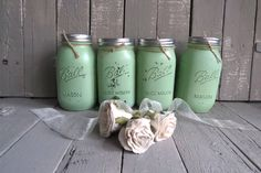 "Charming vintage painted mason jars for your farmhouse kitchen. They are painted a soft pistachio green and distressed slightly. Each jar has a tin screw off rim but no lid and is tied with twine for added warmth and charm. Two of the jars measure 7"" tall with a 2 3/4"" lid, while the other two jars measure 6 1/2"" high with a 3 1/4"" lid. Sold as a set of four. www.swede13.etsy.com"