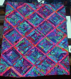 FIRE & ICE --Dramatic Kaffe Fassett inspired lap quilt made mostly with intense blues and purples, which strongly contrast against the