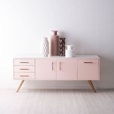 The 'Diaz Credenza' sideboard, part of Kelly Hoppen's 'Retrospective' collection, £2,179, and geometric vases, from £35 each (kellyhoppen.com)