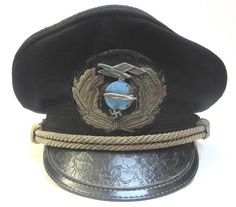 This reproduction Zeppelin Captains Cap has had medium wear and has been aged to look 70+ years old. It is stained, in places, has a blue officers cover, the leather sweatband has stains and the wreath and chinstrap show dark tarnishing. www.warhats.com
