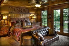 Luxury rustic bedroom design with leather and wood bed. Land's End Development