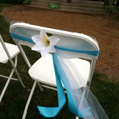 Outdoor wedding chair decorations (only i want a yellow flower instead)