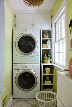 Stacking washer and dryer. Small laundry room.
