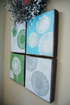 Doily wall art.  Using spray paint and paper doilies.