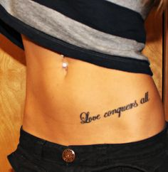 My first tattoo!  Love conquers all  tattoo  quote  hip tattoo