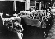 <b>1963</b> | New York Commuters read of John F. Kennedy's assassination, November 1963. This Carl Mydans photo did not appear in LIFE when the magazine published as a weekly, but has been printed in later books.
