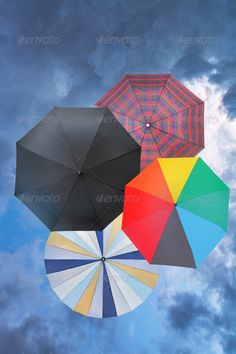 four open umbrellas with blue rainy clouds ...  above, accessory, background, black, blue, check, checkered, chequered, classic, cloud, cloudscape, cloudy, colorful, dark, different, few, four, full, grey, magenta, many-coloured, multicolor, multicolored, nature, open, orange, outdoors, plaid, rain, rainy, red, scene, scenic, season, set, several, sky, square, storm, striped, top, umbrella, view, weather, yellow