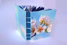 Size: A7 (Pocket): 11 cm (4.3) by 8 cm (3.2) 196 colored unlined pages (counting front and back): 56 blue pages & 140 white pages 7 signatures (groups of paper)  This handmade notebook would make a perfect pocketbook, small travel journal or a special gift. Wonderful for all types Handmade Notebook, White Pages, Cherry Blossom, Special Gifts, Counting, Journal, Pocket, Paper, How To Make