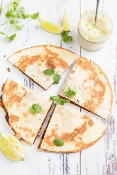 Vegan Sweet Potato Quesadilla Recipe - With black beans, smoked paprika and coriander and ground cumin, these vegan sweet potato quesadillas are hearty and packed full of flavour. Serve with a generous dollop of lime cashew cream and an extra squeeze of lime along with a side salad for a delicious weeknight dinner. | Click to get the recipe