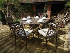 Casino 6 Seater Round Table and Chairs 'set' Round Folding Table, Round Table And Chairs, Oval Table, Table Legs, Aluminium Garden Furniture, Small Outdoor Spaces, Beige Cushions, Cost Of Goods, Under The Table