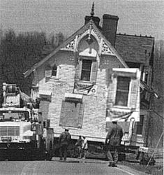 This picture made the local newspapers in Indianapolis, Indiana. It is a picture of the mansion (also called the Hannah house by locals) being moved. As you can see the house was boarded and there was nobody in the house. Yet, there is an image of a girl looking out of the window. The house is reputed to be very haunted and is on the top ten haunted places in USA.