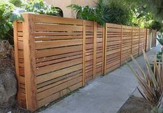 Outdoor living made private with this unique wood fence
