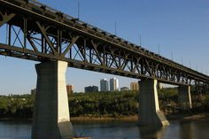 High Level Bridge, Edmonton AB - I used to live a couple of blocks away from here and would run here in the evenings and watch the sun set over the river almost every evening. Over The River, High Level, Abandoned Places, Bridges, Canada, Couple, Sunset, Watch, History