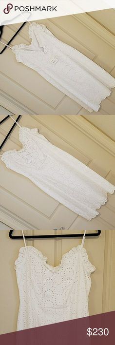 Moschino White Dress. Brand NEW! Low back. Sz 12. Moschino White Dress Brand NEW! Low back cut. Sz 12. With tags Moschino Dresses Midi