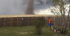 Canadian man calmly mows lawn during twister in epic photo #U_S_A_ #iNewsPhoto