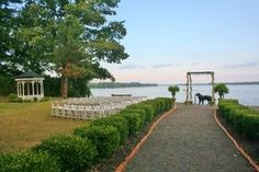Waterfront ceremony with arch at he Glen Foerd Mansion