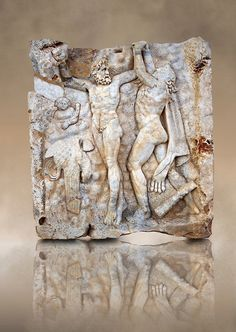 Roman relief sculpture, Aphrodisias, Turkey. Prometheus is screaming in pain. Zeus had given him a terrible punishment for giving fire to man: he was tied to the Caucasus mountains and had his liver picked out daily by an eagle. Herakles shot the eagle and is undoing the first manacle. He wears his trade mark lion-skin and thrown his club to one side. A small mountain nymph, holding a throwing stick appears amongst the rocks.