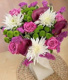 Fuchsia Flame Romantic pink Aqua Roses and hot pink Calla Lilies are complemented with pretty white Anastasia Wedding Bells, Wedding Flowers, Bouquet Flowers, Flowers By Post, Aqua Rose, Calla Lilies, Just Giving, Anastasia, Beautiful Flowers