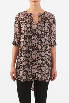 Graphic floral vine print patterns our softly gathered boho tunic styled with a flirty keyhole at the scoop neckline and a high-low hemline.