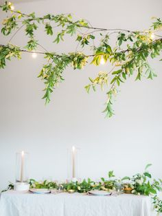 Wedding DIY Project:  How to add green foliage to cafe lights!  Photo: Erin Kate + styling and design by The Gatherist and Tinge Floral.