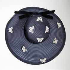 What's not to love about a sweet swarm of butterflies encircling a chic navy blue 1940s hat?