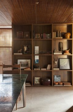 An Incredible Brazilian Home That Celebrates Art, Travel, and Nature - Photo 6 of 14 - Art, photographs, and sculpture are thoughtfully displayed throughout the home.