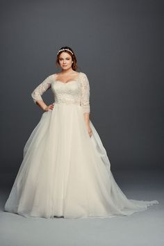 Organza plus size wedding dress. Click on the image to see our full gallery of plus size wedding dress inspirations.