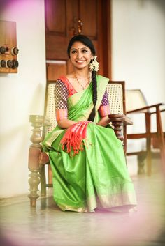 South Indian bride. Temple jewelry. Jhumkis.Green silk kanchipuram sari with contrast blouse.Side Braid with fresh flowers. Tamil bride. Telugu bride. Kannada bride. Hindu bride. Malayalee bride.