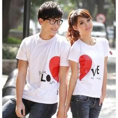 "Would You Wear Matching Shirts for Couples? - These cute shirts have half of a heart on each shirt. On his shirt it says, ""Make LO"" and on her shirt it says, ""VE not war."" So when the couple stands side by side the hearts join and it says, ""Make Love, Not War."""