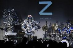 A guitarist named Mach, a drummer named Ashura, and a keyboardist named Cosmo may sound part and parcel of your regular rock band. But once you see that this particular guitarist has 78 fingers and 12 guitar picks, the drummer rocks out with 22 sticks, and the keyboard player shoots laser beams out of its [...]