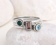 Mother's Three Birthstone Rings Stack Band Sterling Silver by Nelle and Lizzy. Each birthstone stands for special person in your family. by NelleandLizzy on Etsy https://www.etsy.com/listing/214821263/mothers-three-birthstone-rings-stack