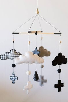 Super Adorable Mobile with Fluffy Clouds and a Glittery Star. I love the monochrome theme nurseries! I think the neutral color combos are timeless and will suit both baby boys and girls. I wanted this mobile to blend with the woodland/mountain themed rooms so I added an accent plaid