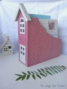 Decorated magazine holder - do several for a row of townhouses