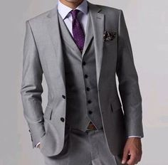 Men's grey suit with purple tie                                                                                                                                                                                 More