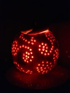 My pumpkin I carved!  First, I made a design with black sharpie.  Next I used a drill to carve the little holes in after I cleaned out the whole pumpkin!