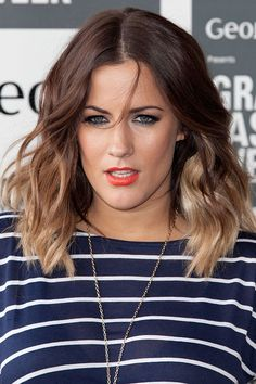 Medium Wavy Hairstyle for Ombre Hair/Getty Images