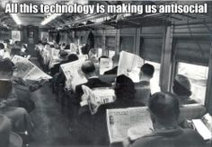 """""""All this #technology is making us antisocial""""  #social #people #newspaper #train #sociality"""