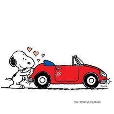 Snoopy washing a red convertible VW Bug