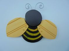 I created this whimsical bumble bee from reclaimed wood, paint, and twisted wire.  Yes, simple in design, but fun.  Great for your home or your