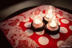 centerpieces for the reception out of votive candle holders glued to decorated hockey pucks: by sybil