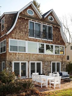 Apply stone veneer - Nothing carries pedigree and permanence like stone. It's a great option for dressing up exterior features such as concrete foundations, column footings, and other masonry details. Fresco, Wood Shingles, Lounge, Stone Veneer, Better Homes And Gardens, Exterior Design, Diy Exterior, Stone Exterior, Architecture Details