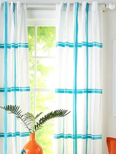 Casual embellished curtains  Give plain white curtain panels a fresh look with an oversize tattersall pattern. We used aqua grosgrain ribbon in two widths to create the effect. The next three slides show you how to make this project.