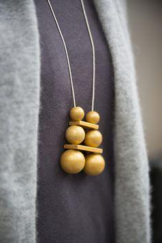 Kette mit goldenen Holzkugeln // necklace with wooden golden balls by Liebelu via DaWanda.com