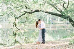 Romantic engagement photos under the oak tree, near the water, at Charlestowne Landing by Aaron and Jillian Photography