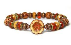 Rustic Orange Beaded Bracelet with Flower focal bead