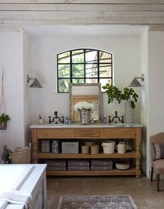 This is so pretty.  Love the window  - the white - against the warmth of the floor and cabinet.