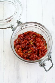 Preserve a little bit of summer by drying cherry tomatoes in the oven. Easy to do, and so delicious! Oven-dried tomatoes add a ton of flavor to recipes!