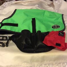 Doggy bundle A very nice green dog coat and a new Stow and Go leather fanny pack size small. Stow and go Other